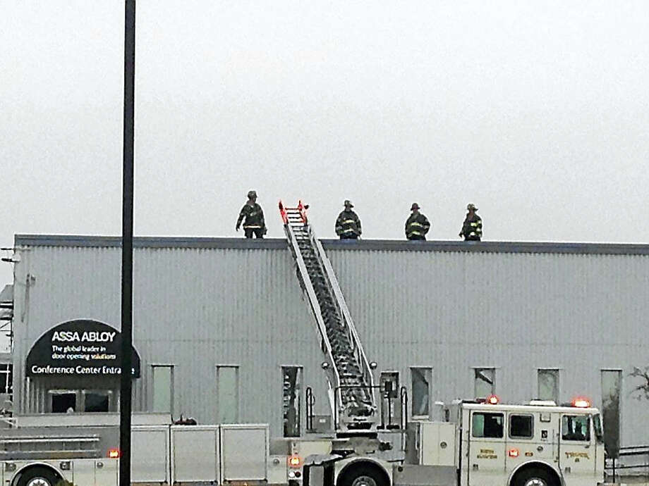 Scene of the Assa Abloy machinery fire at 100 Sargent Drive, New Haven Photo: Juliemar Ortiz — New Haven Register