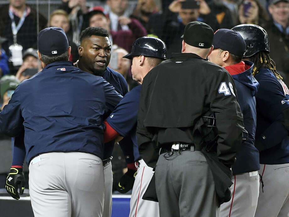 Boston Red Sox manager John Farrell, left, and teammates push designated hitter David Ortiz, second from left, away from umpire Ron Kulpa (46) as Ortiz reacts to a called second strike off of New York Yankees relief pitcher Andrew Miller in the ninth inning Friday. Photo: Kathy Kmonicek — The Associated Press   / FR170189 AP