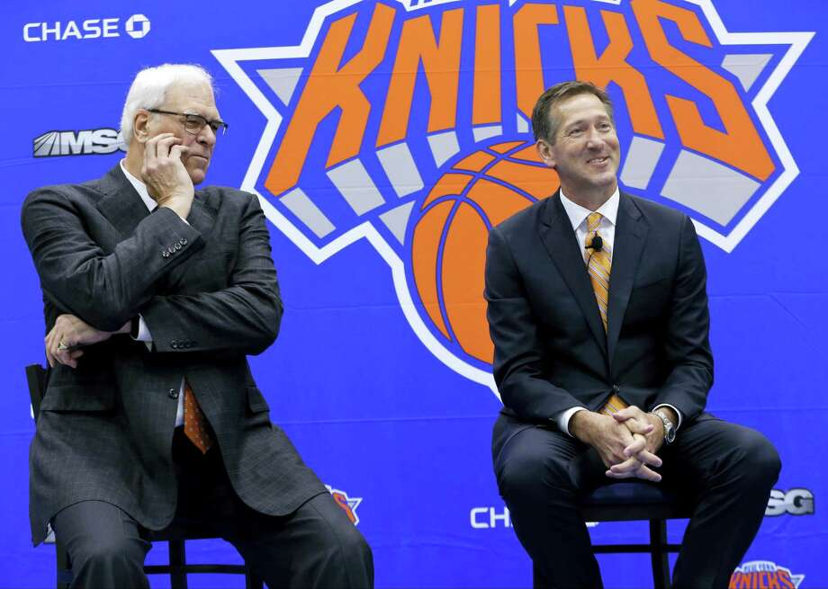 Newly introduced Knicks coach Jeff Hornacek, right, responds to a question during a news conference as team president Phil Jackson listens on Friday. Photo: Frank Franklin II — The Associated Press   / Copyright 2016 The Associated Press. All rights reserved. This material may not be published, broadcast, rewritten or redistribu