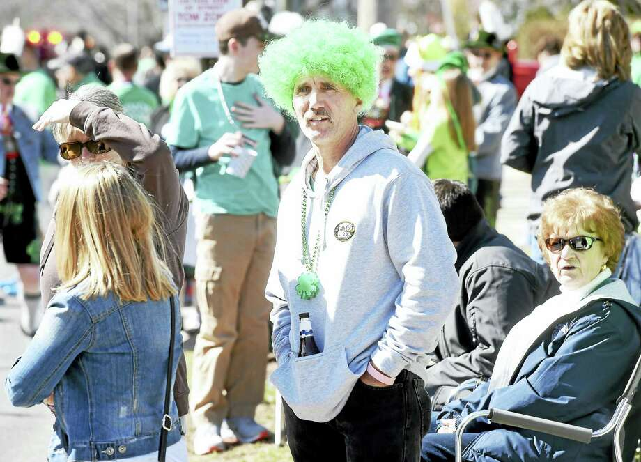 Gary Hottin, center, of North Branford watches the annual Milford St. Patrick's Day Parade on Saturday, March 12, 2016. Hottin grew up in Milford. Photo: Arnold Gold — New Haven Register