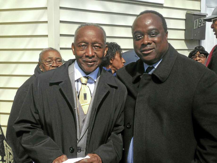 Bishop Colon Haywood Sr.and his son, The Rev. Colon Haywood Jr., at the corner of Newhall and Ivy streets, named in the elder Haywood's honor. Photo: Juliemar Ortiz — New Haven Register