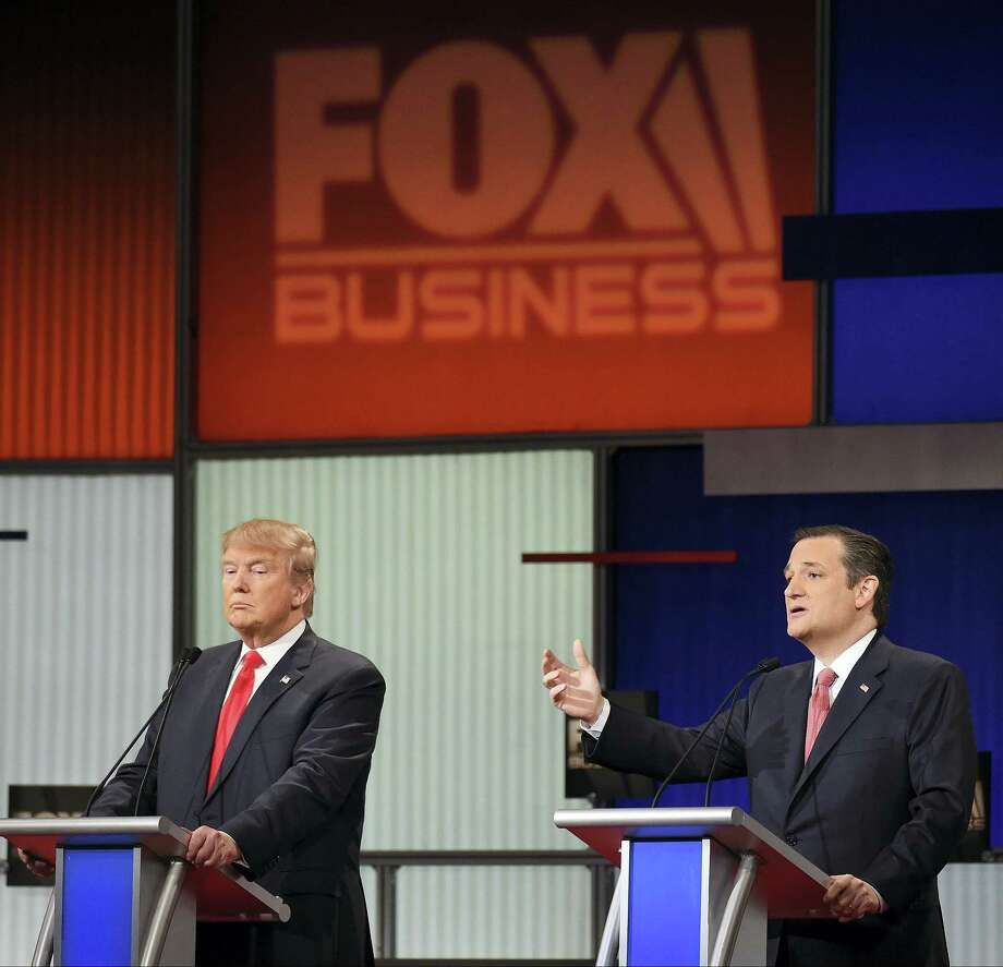 Republican presidential candidate Sen. Ted Cruz, R-Texas, right, speaks as Republican presidential candidate Donald Trump looks on during the Fox Business Network Republican presidential debate at the North Charleston Coliseum Thursday. Photo: THE ASSOCIATED PRESS   / FR155191 AP