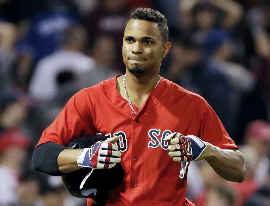 Xander Bogaerts reacts after striking out in the ninth inning on Friday. Photo: Elise Amendola — The Associated Press   / AP