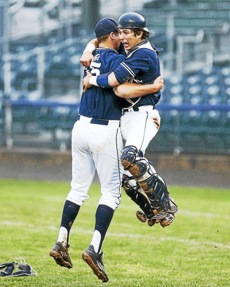Yale pitcher Chasen Ford celebrates with catcher Andrew Herrera after the Bulldogs beat Dartmouth 5-4 to wint the Ivy League Red Rolfe Division title on Saturday at Yale Field. Photo: John Vanacore — For The Register   / (C)John H.Vanacore