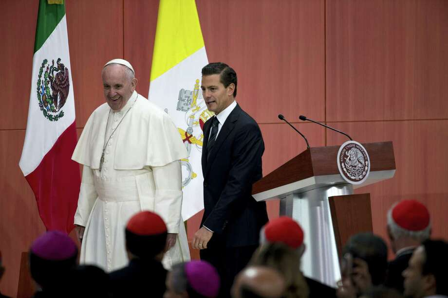 Pope Francis, left, walks with Mexican President Enrique Pena Nieto as they leave the stage following a welcoming ceremony at the National Palace in Mexico City, Saturday, Feb. 13, 2016. The Pope kicks off his first trip to Mexico on Saturday with speeches to the country's political and ecclesial elites. The pontiff's five-day visit will include a very personal prayer before the Virgin of Guadalupe shrine, the largest and most important Marian shrine in the world and one that is particularly important to the first Latin American pope. Photo: AP Photo/Rebecca Blackwell    / AP