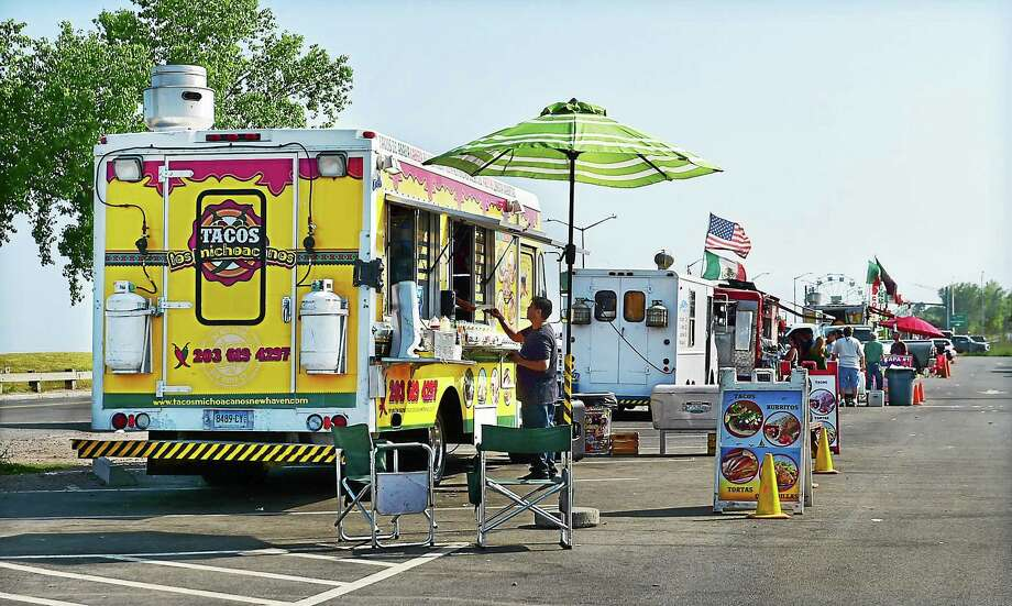Last year's New Haven Food Truck Festival on New Haven's historic Long Wharf waterfront went well. This year's festival will be held Saturday and Sunday. Photo: New Haven Register File Photo   / New Haven RegisterThe Middletown Press