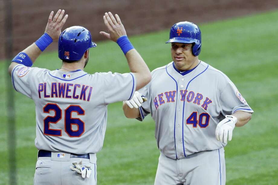 The Mets' Bartolo Colon, right, is greeted by teammate Kevin Plawecki (26) after hitting a two-run home run during the second inning on Saturday. Photo: Gregory Bull — The Associated Press   / Copyright 2016 The Associated Press. All rights reserved. This material may not be published, broadcast, rewritten or redistribu