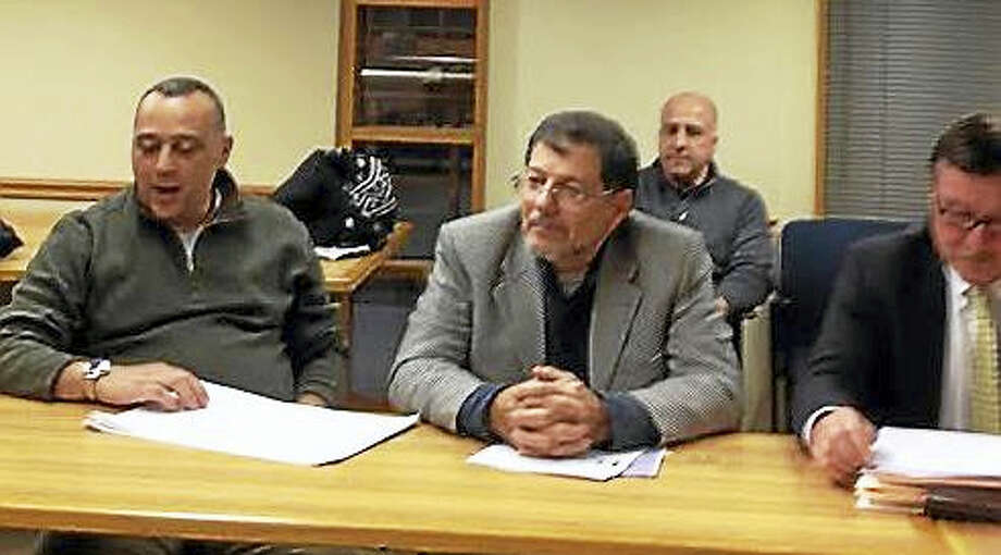 From left, Charbel Eid and Hosam Afifi will open a food court at 27-33 Church St. Their attorney, James Perito, is at right. The property's co-owner in back row is Salvatore Comunale. Photo: MARY O'LEARY — NEW HAVEN REGISTER
