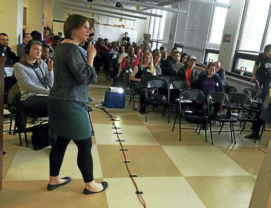 Alycia Santilli of CARE discusses some of the findings of the 2015 New Haven Health Survey during a forum Saturday, May 7, at ConnCAT in New Haven. Photo: Esteban L. Hernandez — New Haven Register