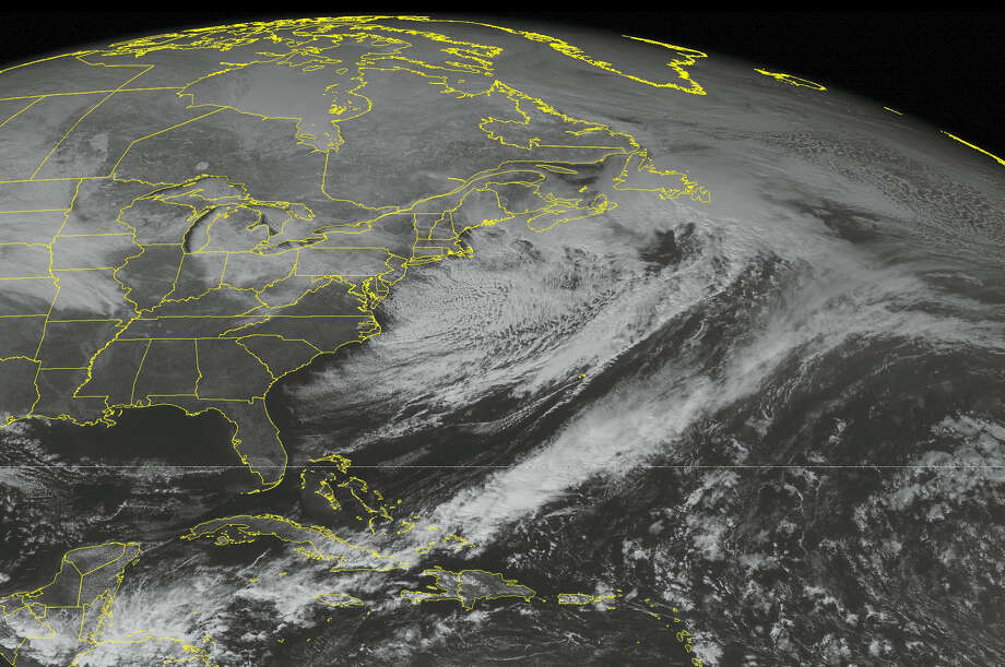 This NOAA satellite image taken Saturday, Feb. 13, 2016 at 12:45 PM EDT shows a cold front sweeping across New England, with lake effect snow showers from Michigan to western New York. Strong winds and much lower temperatures will dive southward from Canada into New England and the Mid Atlantic. A warm front edges into the middle Mississippi valley with scattered snow showers. Widespread high pressure over the southeastern United States with mostly sunny skies. Photo: AP PHOTO/WEATHER UNDERGROUND / WEATHER UNDERGROUND