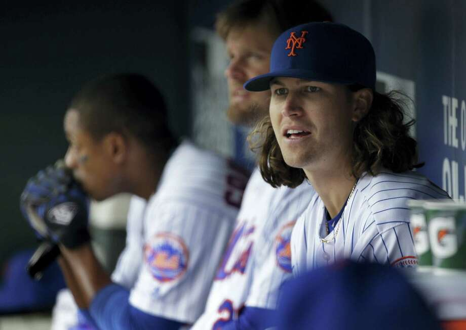 Mets pitcher Jacob deGrom watches from the dugout during the fourth inning on Friday. Photo: Julie Jacobson — The Associated Press   / Copyright 2016 The Associated Press. All rights reserved. This material may not be published, broadcast, rewritten or redistributed without permission.