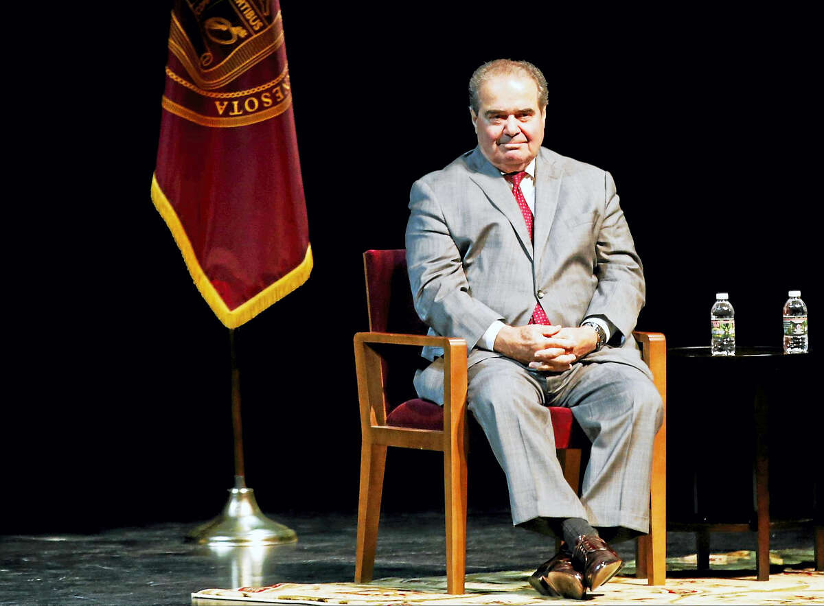 FILE - In this Oct. 20, 2015, file photo, U.S. Supreme Court Justice Antonin Scalia waits during an introduction before speaking at the University of Minnesota as part of the law school's Stein Lecture series in Minneapolis. The presence of three women on the Supreme Court isn't enough to persuade Scalia that the court has become a diverse body. In remarks Wednesday, Nov. 11, in Philadelphia, Scalia noted that four of its members are from New York City, a fifth from New Jersey and two more from California.