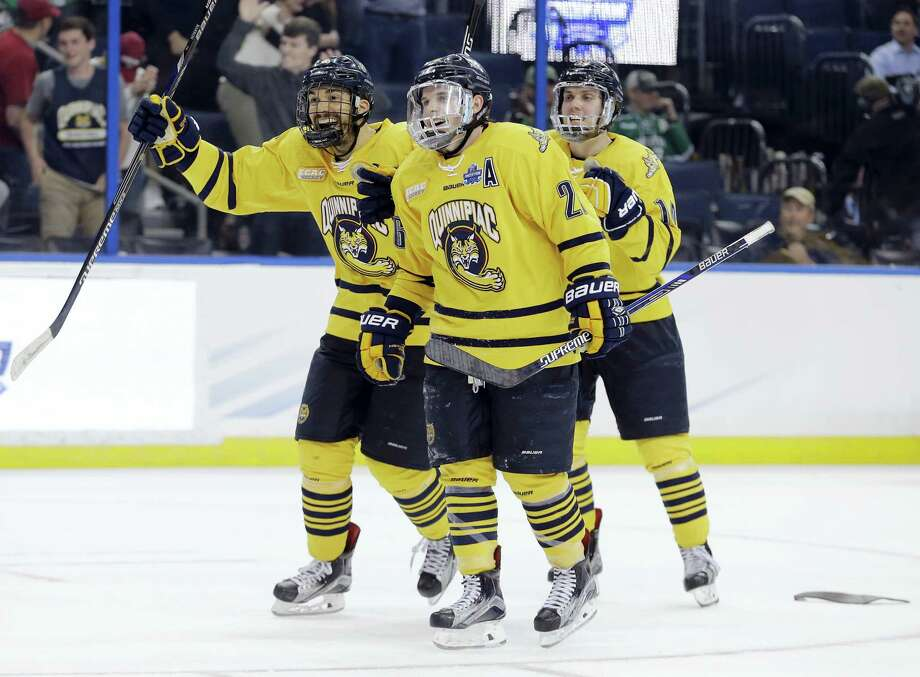 Quinnipiac defenseman Alex Miner-Barron, left, and forward Travis St. Denis celebrate the team's 3-2 win over Boston College in the semifinals on Thursday. Photo: Chris O'Meara — The Associated Press   / AP