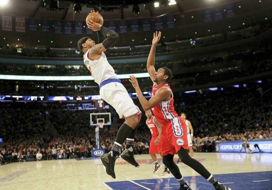 Carmelo Anthony, left, puts up a shot over the 76ers' Hollis Thompson during the second half Monday. Photo: Seth Wenig — The Associated Press   / AP