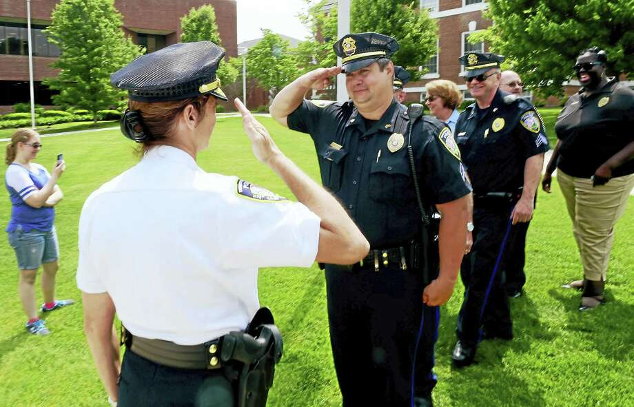 In this file photo, the new University of New Haven Police Chief Tracy L. Mooney, left, returns a salute from UNH police Sgt. Kevin Holster after a swearing in ceremony for Chief Mooney Wednesday, June 1, 2016, at the University of New Haven. Mooney, a former Milford police deputy chief and the first female police chief at the university, replaces retired UNH Police Chief Mark DeLieto. Photo: Peter Hvizdak — New Haven Register   / ©2016 Peter Hvizdak