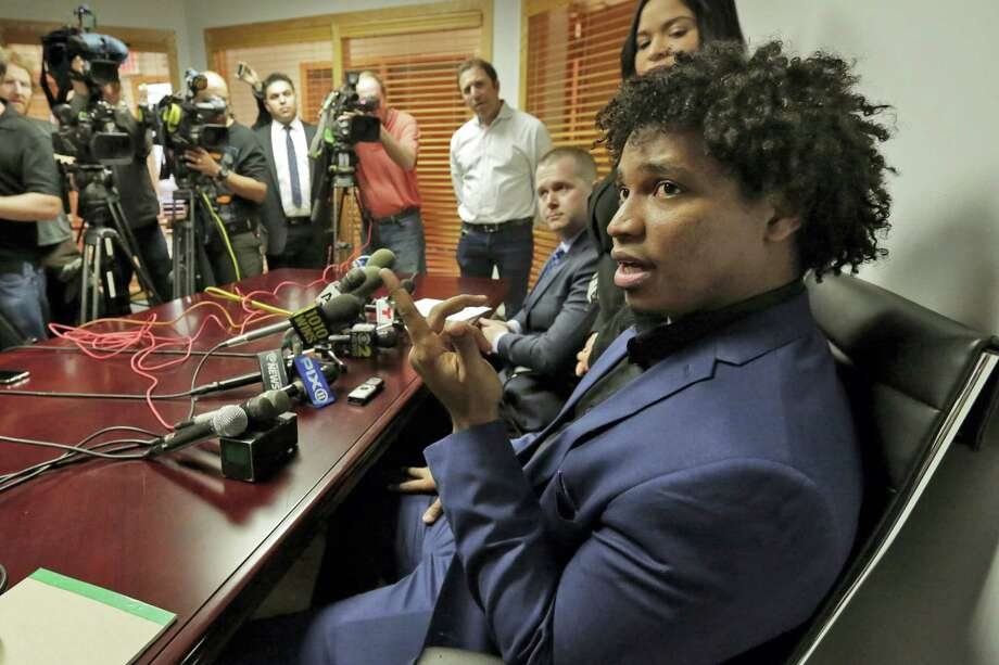 Former Mets pitcher Jenrry Mejia, right, addresses a news conference at the office of his attorney Vincent Peter White, seated second from right, in New York on Friday. Photo: Richard Drew — The Associated Press   / Copyright 2016 The Associated Press. All rights reserved. This material may not be published, broadcast, rewritten or redistributed without permission.