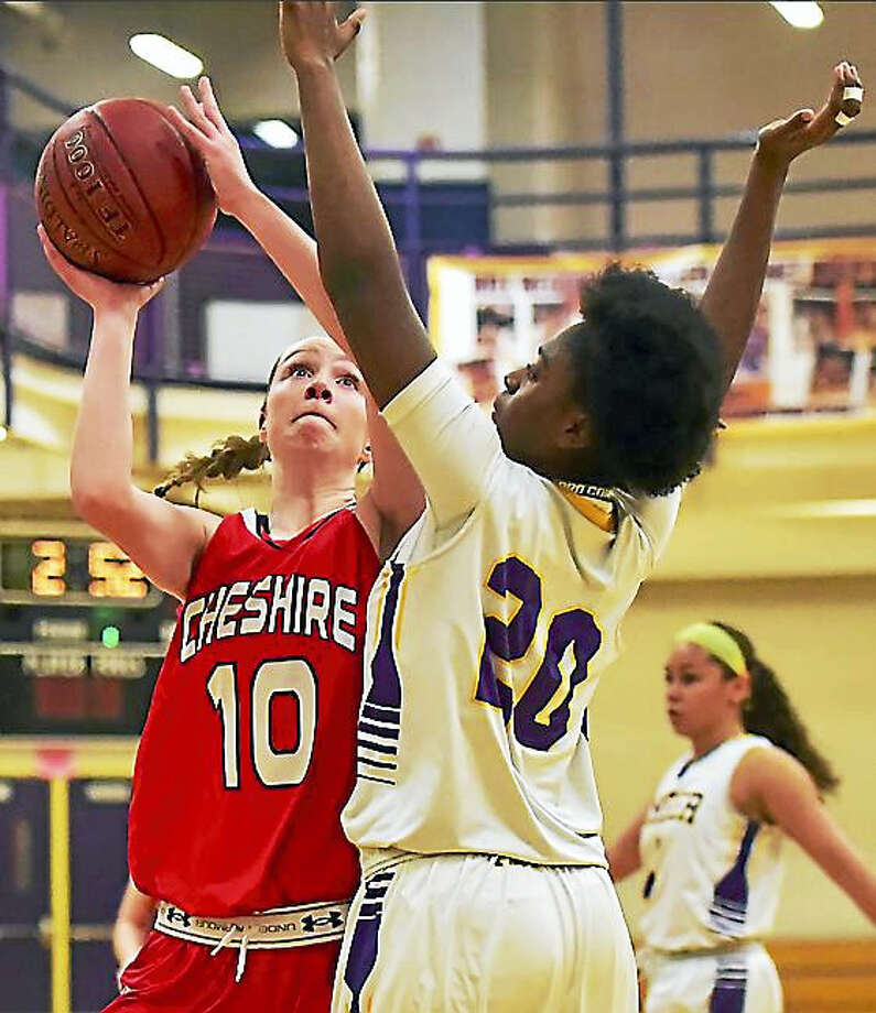 Cheshire fell to the Career Panthers in a close game, 58-55, last week. Rams coach Sarah Mik, who has led the team for 20 seasons, says she's having fun in her final season. Photo: Catherine Avalone — New Haven Register