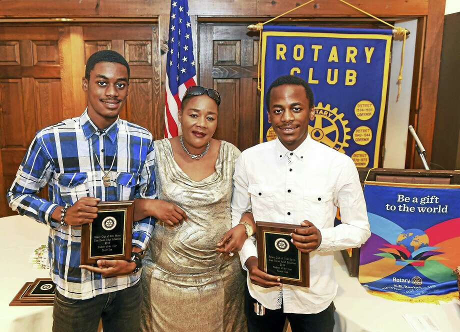 Christ Sam, left, and his brother Miracle Sam, with their mother Jeanine Sam, center, are recipients of the West Haven Adult Education Program Student of the Year Award that they received during a Rotary Club meeting at App's Ristorante in West Haven Wednesday afternoon. The brothers from the Democratic Republic of Congo, were in a refugee camp for several years in Zambia until they came to America. Photo: Peter Hvizdak — New Haven Register   / ©2016 Peter Hvizdak