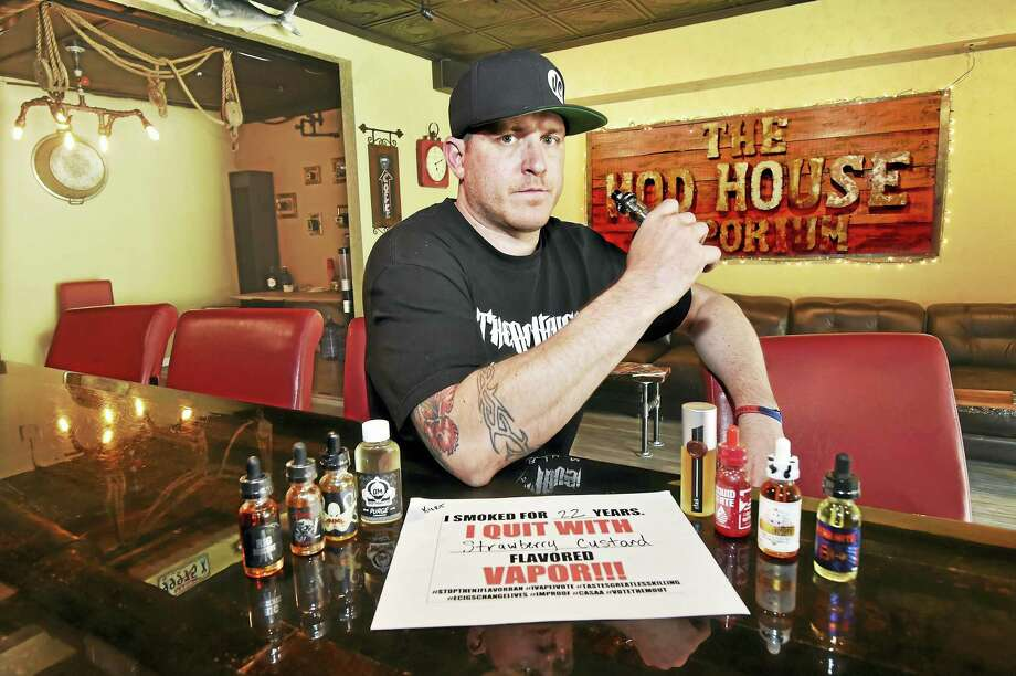 Kurt Buckholz, co-owner of The Mod House Vaporium, at 113 River Street in Milford and 362 Main Street Wallingford is photographed at his Milford vaping bar, Wednesday, June 1, 2016. Buckholz said the new guidelines by the U.S. Food and Drug Administration for mixing or preparing liquid nicotine or nicotine-containing e-liquids for vaping are unfair and could drive them out of business in just a few years. After smoking cigarettes for 22 years, Buckholz quit nicotine by vaping strawberry custard vape juice. (Catherine Avalone - New Haven Register) Photo: Journal Register Co. / New Haven RegisterThe Middletown Press