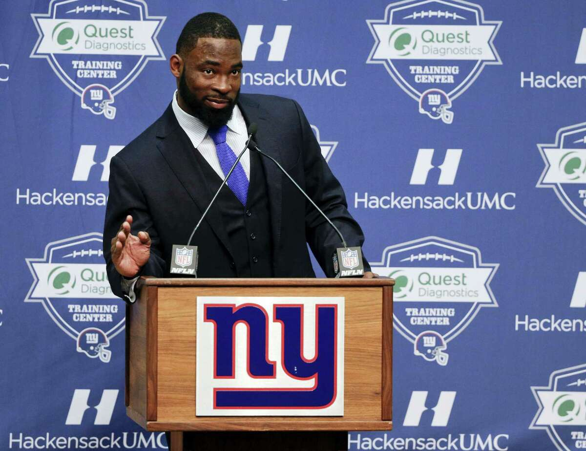 New York Giants defensive end Justin Tuck speaks during a news conference at which he announced his retirement, Friday.