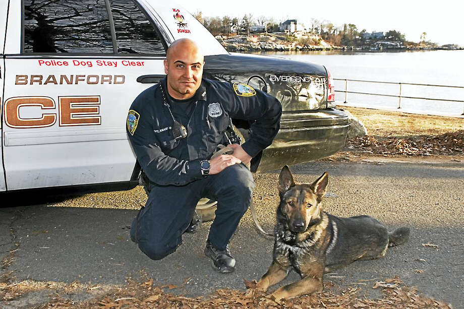 Branford Police Officer Luigi Amasino and police canine Joker. Photo: Contributed Photo