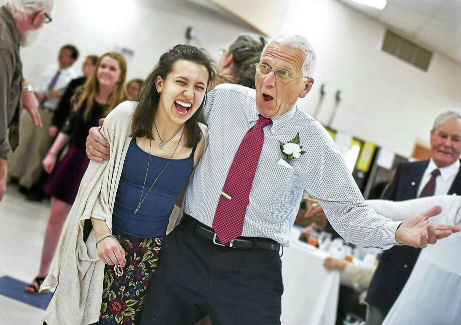"""Mike Student, a 1962 graduate of Ansonia High School, dances with Shelton High School senior Sarah Henckel to """"Twist and Shout"""" Thursday at the Human Relations Club's annual inter-generational """"senior prom"""" at Ansonia High. Photo: CATHERINE AVALONE — NEW HAVEN REGISTER   / New Haven RegisterThe Middletown Press"""