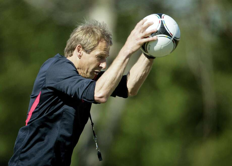 US coach Jurgen Klinsmann slams the ball to the ground during a practice at the FIU Soccer Stadium in Miami. Photo: The Associated Press File Photo   / Copyright 2016 The Associated Press. All rights reserved. This material may not be published, broadcast, rewritten or redistribu