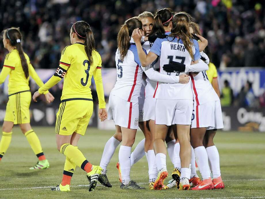 The United States women's team celebrate a goal by United States' Crystal Dunn during the first half of an international friendly soccer match against Colombia at Pratt & Whitney Stadium at Rentschler Field, Wednesday, April 6, 2016, in East Hartford, Conn. The U.S. won 7-0. (AP Photo/Jessica Hill) Photo: AP / FR125654 AP