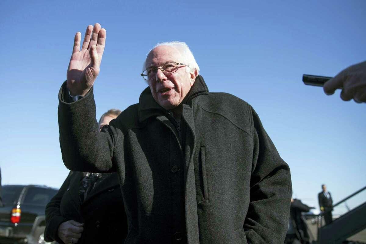 Democratic presidential candidate Sen. Bernie Sanders, I-Vermont, gestures as he speaks with media Friday upon his arrival in Minneapolis.