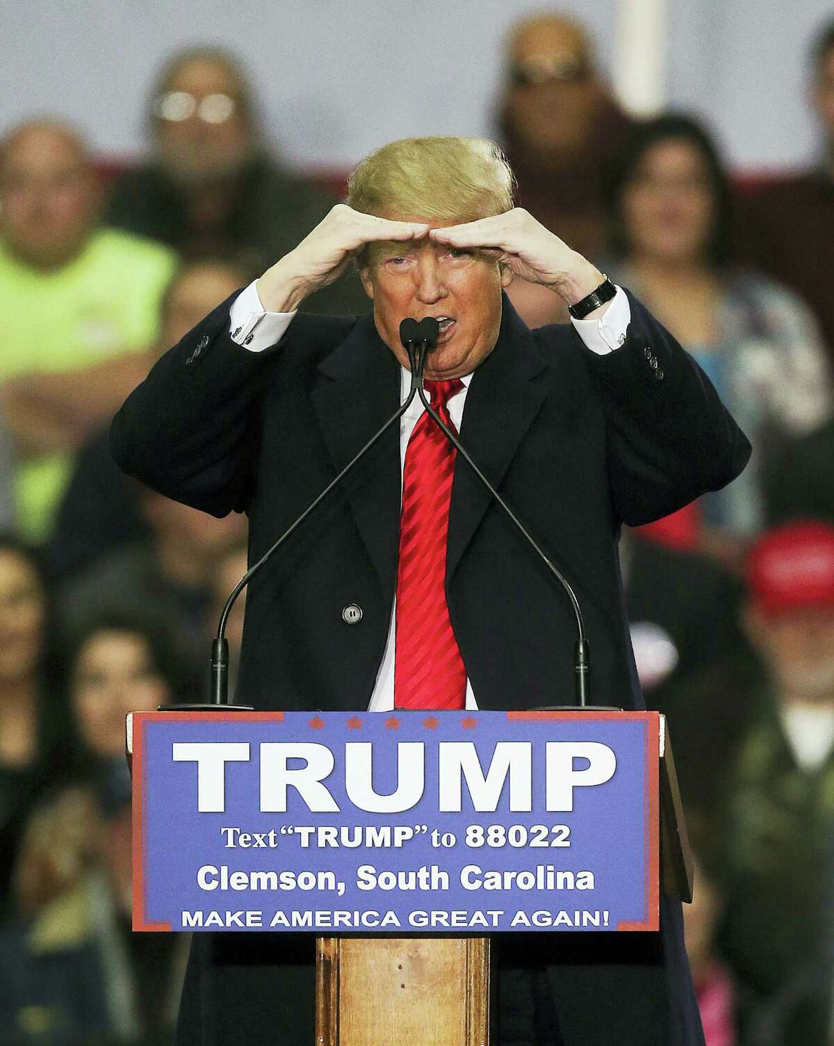 Republican presidential candidate Donald Trump strains to see as he speaks during a rally at Clemson University Wednesday in Pendleton, S.C.
