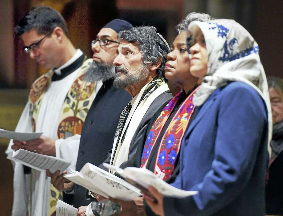 (Arnold Gold-New Haven Register)  Rabbi Herbert Brockman (center) of Congregation Mishkan Israel in Hamden and area clergy participate in the Interfaith Prayer Service opening the 200th Anniversary Celebration of Trinity Episcopal Church on the New Haven Green Sunday. Photo: Journal Register Co.