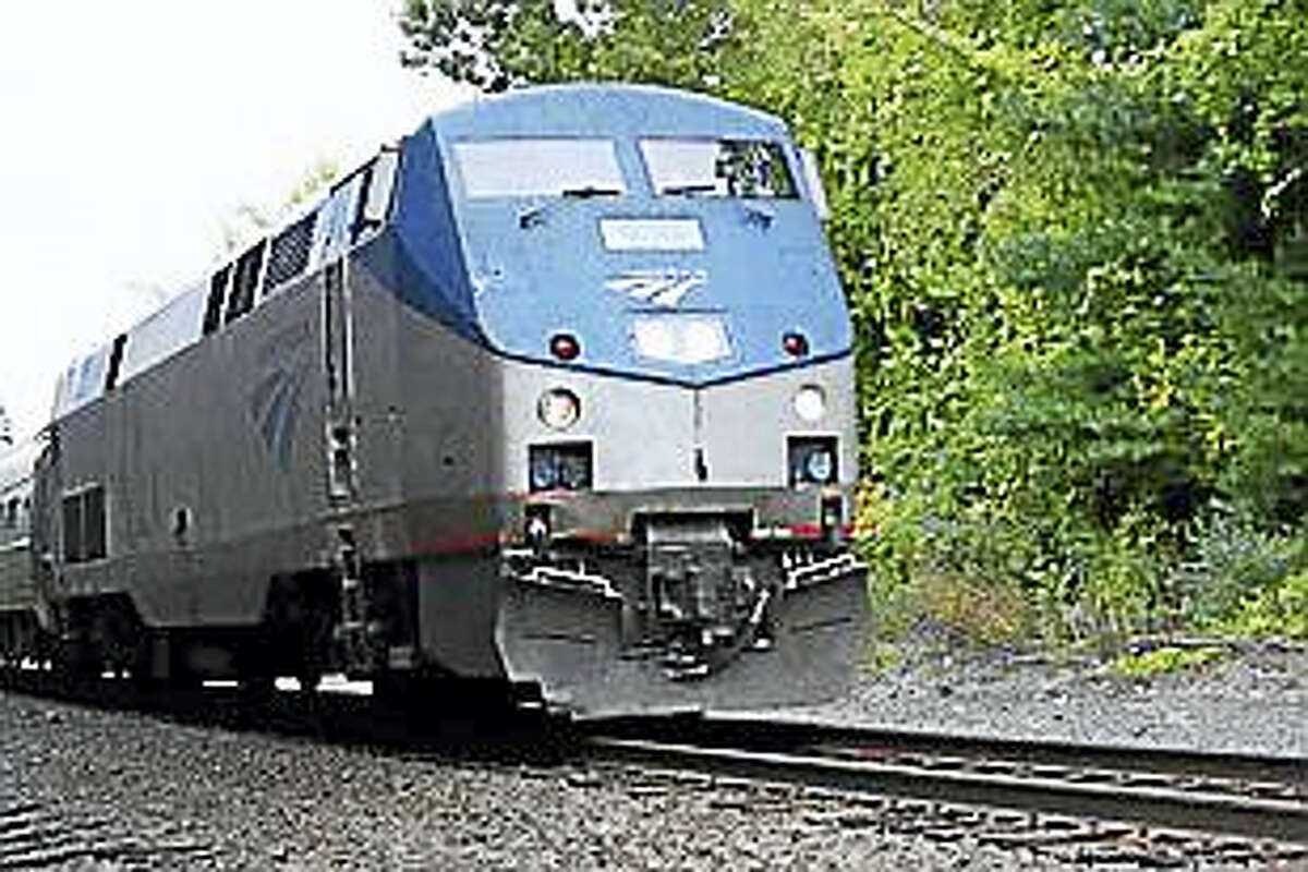 An Amtrak train passing through Enfield in 2014.