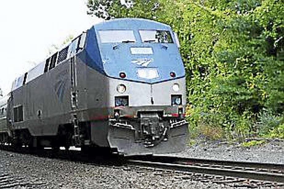 An Amtrak train passing through Enfield in 2014. Photo: Hugh Mcquaid — CTNewsJunkie File Photo