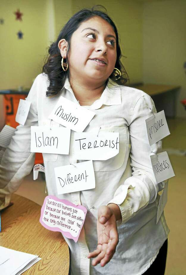 Sandi Ortega, 17, talks about her project concerning discrimination against Muslims during a Social Justice Symposium at High School in the Community in New Haven. Photo: Arnold Gold — New Haven Register
