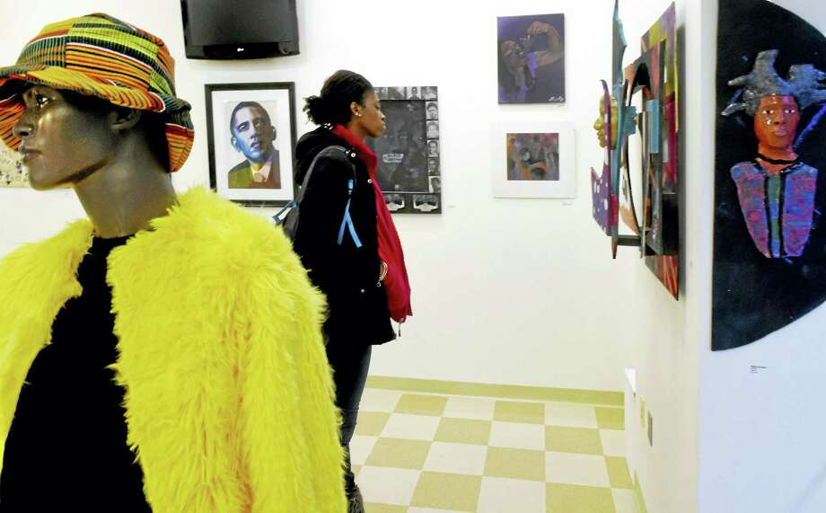 Shakira Mclain, 16, a Cooperative Arts and Humanities High School junior, takes a walk through the student-curated art exhibit Thursday. Photo: Peter Hvizdak — New Haven Register   / ©2016 Peter Hvizdak