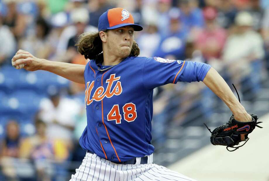 New York Mets starting pitcher Jacob deGrom throws during the first inning of an exhibition spring training baseball game against the New York Yankees Wednesday, March 9, 2016, in Port St. Lucie, Fla. (AP Photo/Jeff Roberson) Photo: AP / Copyright 2016 The Associated Press. All rights reserved. This material may not be published, broadcast, rewritten or redistributed without permission.