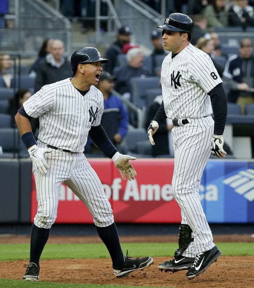 Mark Teixeira, right, is greeted by Alex Rodriguez after hitting a home run against the Astros on Thursday. Photo: Julie Jacobson — The Associated Press   / Copyright 2016 The Associated Press. All rights reserved. This material may not be published, broadcast, rewritten or redistributed without permission.