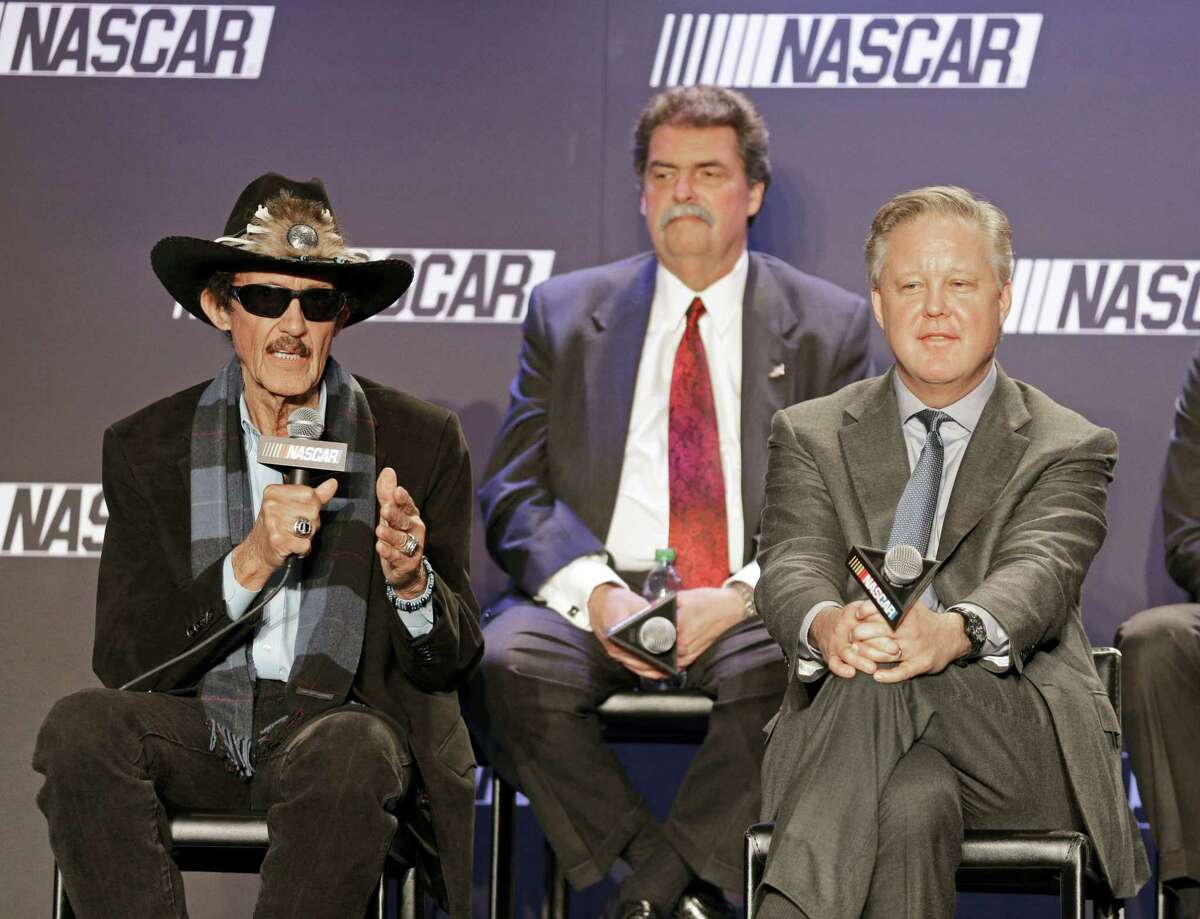 Team owner Richard Petty, left, speaks as NASCAR Chairman and CEO Brian France, right, and NASCAR president Mike Helton, back, listens during a news conference on Tuesday.