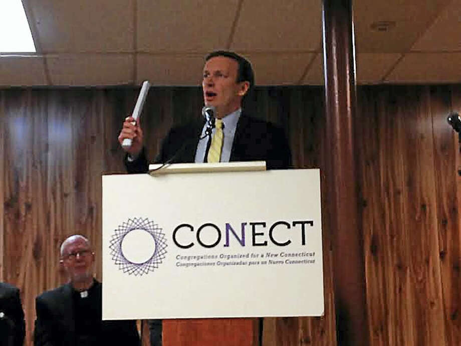 U.S. Sen. Chris Murphy, D-Conn., addresses CONECT at St. Rose of Lima Parish in New Haven. Photo: Brian Zahn - New Haven Register