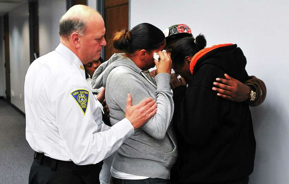 New Haven Police Chief Dean Esserman comforts the family of Brian Gibson after a press conference at New Haven police headquarters announcing the arrest of Jahmal Fulcher for the homicide of Gibson. Photo: NEW HAVEN REGISTER File Photo