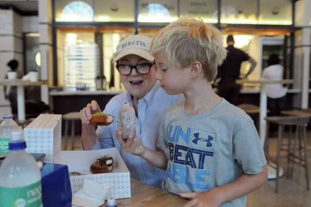 Jackie Beretta and her grandson, Waylon Ford, were among the earliest customers at Maybelle's Donuts in the new Pearl food hall, The Bottling Department, Monday morning.