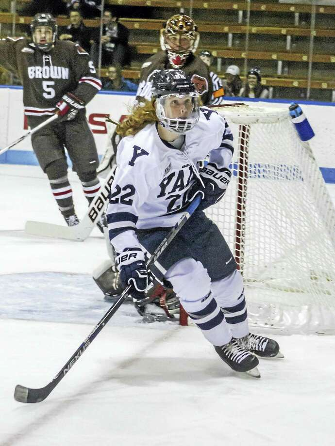 Yale's J.M. Piotrowski's flowing red locks have become something of a hallmark to the Ingalls Rink faithful this season. Photo: Photo By Steve Musco   / Steve Musco
