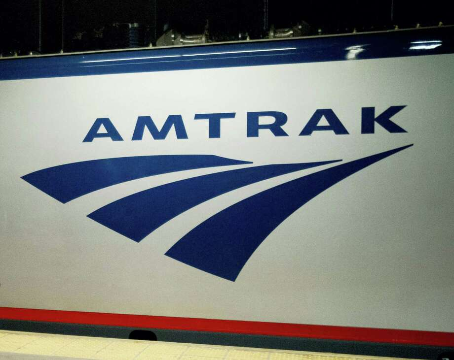 An Amtrak logo is seen on a train at 30th Street Station in Philadelphia. Photo: AP Photo — Matt Rourke, File / AP