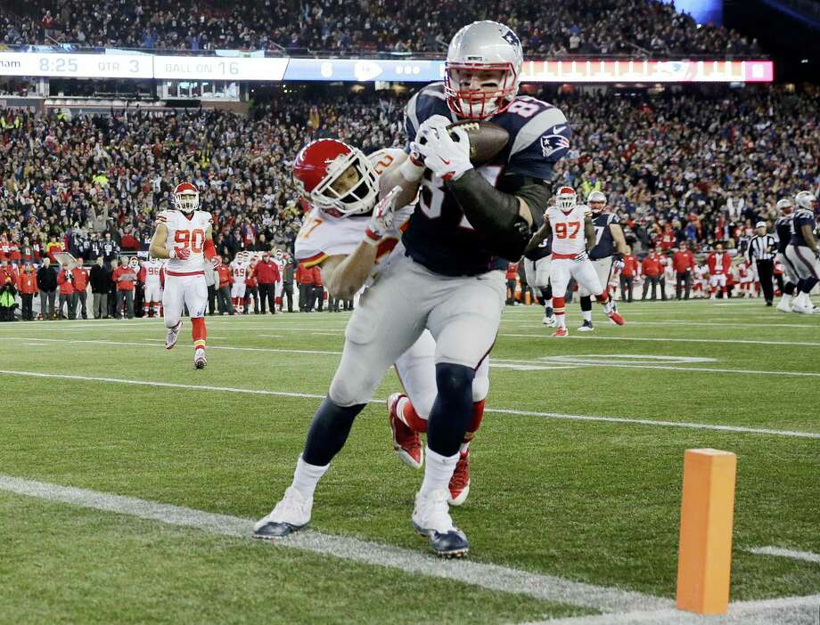 Patriots tight end Rob Gronkowski (87) catches a pass for a touchdown ahead of Chiefs defensive back Tyvon Branch in the second half on Saturday. Photo: Charles Krupa — The Associated Press   / AP