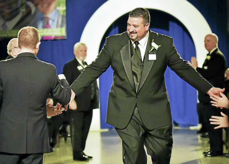 Joe Andruzzi, the 2015 Walter Camp Football Foundation Man of the Year is introduced at Saturday's awards dinner at Yale University Commons. Photo: Catherine Avalone — Register   / New Haven RegisterThe Middletown Press