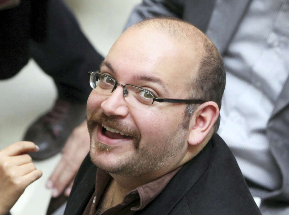 In this photo April 11, 2013 file photo, Jason Rezaian, an Iranian-American correspondent for the Washington Post, smiles as he attends a presidential campaign of President Hassan Rouhani in Tehran, Iran. A source close to Iran's judiciary confirmed to The Associated Press, Saturday, Jan. 16, 2016 that jailed Washington Post bureau chief Jason Rezaian is one of four dual-national prisoners freed by Iran's government and previously announced on Iranian state television without naming those released. Photo: AP Photo/Vahid Salemi, File    / AP