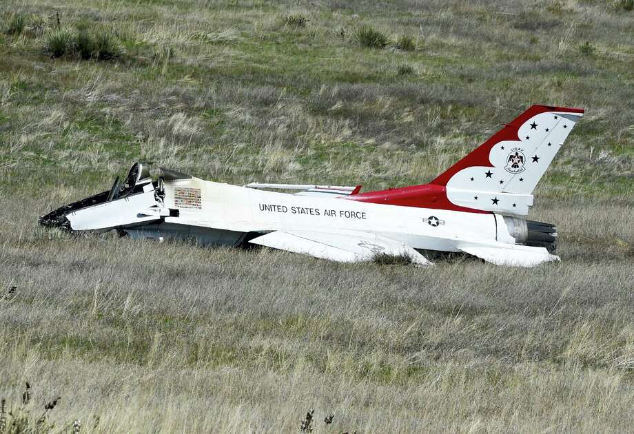 A U.S. Air Force Thunderbird that crashed following a flyover rests on the ground south of the Colorado Springs, Colo., airport after a performance at a commencement for Air Force Academy cadets Thursday, June 2, 2016. The pilot ejected safely from the jet. Photo: Jerilee Bennett — The Gazette Via AP / The Gazette