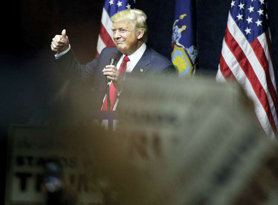 Republican presidential candidate Donald Trump acknowledges cheers from the crowd  during a campaign rally on April 6, 2016 in Bethpage, N.Y. Photo: AP Photo/Julie Jacobson   / AP