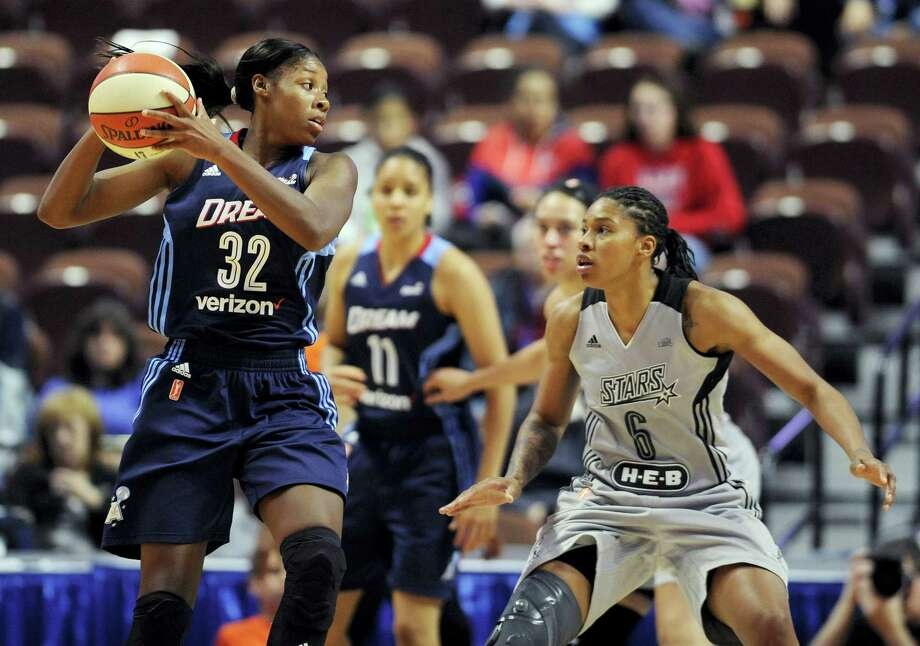 Atlanta Dream's Bria Holmes looks to pass around San Antonio Stars' Alex Montgomery, right, during the second half of a WNBA basketball game, Wednesday, May 4, 2016, in Uncasville, Conn. (AP Photo/Jessica Hill) Photo: AP / AP2016