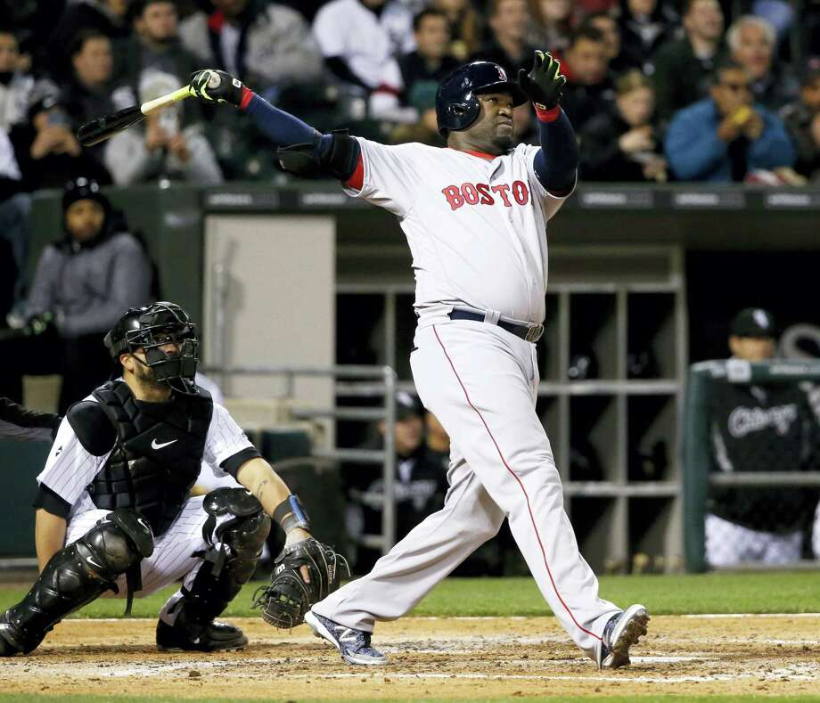 Boston Red Sox's David Ortiz watches his two-run home run off Chicago White Sox starting pitcher Carlos Rodon, also scoring Xander Bogaerts, during the fifth inning of a baseball game Wednesday, May 4, 2016, in Chicago. Watching with Ortiz is catcher Dioner Navarro. (AP Photo/Charles Rex Arbogast) Photo: AP / Copyright 2016 The Associated Press. All rights reserved. This material may not be published, broadcast, rewritten or redistribu
